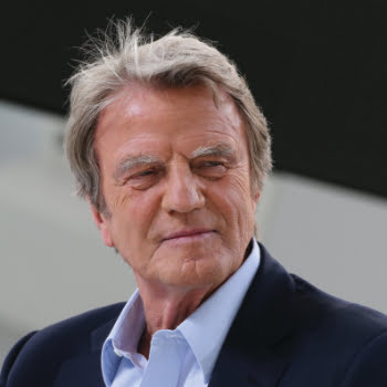 Former French Foreign Minister Bernard Kouchner takes part in a show on the set of the French tv channel Canal Plus on the sidelines of the 67th edition of the Cannes Film Festival in Cannes, southern France, on May 21, 2014. AFP PHOTO / LOIC VENANCE
